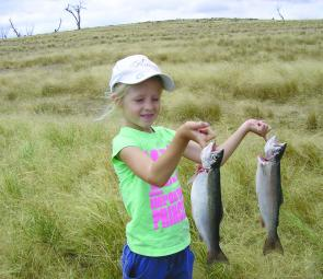 Caitlin Sinclair with two rainbows caught on bardi grubs.